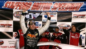 Doug Coby celebrates his Whelen Modified Tour CarQuest 150 victory Friday at Stafford Speedway (Photo: Jim Rogash/Getty Images for NASCAR)