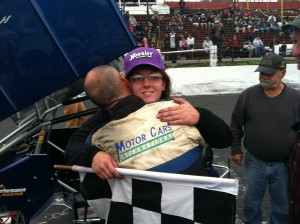 Bethany Stoehr is hugged by her father Greg after winning Sunday's NEMA Midget feature Sunday at the Waterford Speedbowl