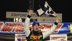 Doug Coby celebrates one of three Whelen Modified Tour victories at Stafford Speedway in 2012 (Photo: Corey Sipkin/NASCAR)