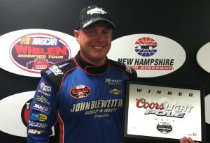 Jimmy Blewett celebrates winning the pole in Whelen Modified Tour qualifying in July at New Hampshire Motor Speedway