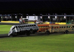Joey Ferrigno making a pass for the lead in a school bus race at Charlotte Motor Speedway (Photo: Kyle Rickey)